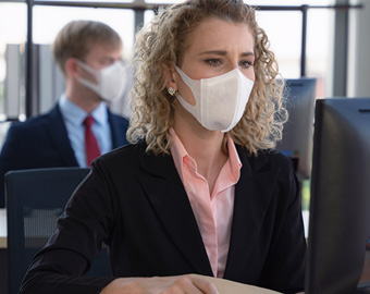 Worker wearing a mask at work